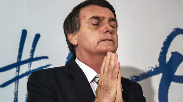 "Brazilian deputy Jair Bolsonaro gestures during a press conference he called to announce his intention to run for the Brazilian presidency in the October 2018 presidential election, at a hotel in Rio de Janeiro on August 10, 2017.<br /> A controversial politician and former army paratrooper, Bolsonaro called himself the ""patriot"" Brazil needs, adding he is the answer to Brazil's rampant corruption, crime and economic malaise. He won more votes than any other congressman from Rio de Janeiro state in the last general elections in 2014 and polls currently show him tied in second place for the presidency, behind leftist former two term president Luiz Inacio Lula da Silva. / AFP PHOTO / Apu Gomes (Photo credit should read APU GOMES/AFP/Getty Images)"